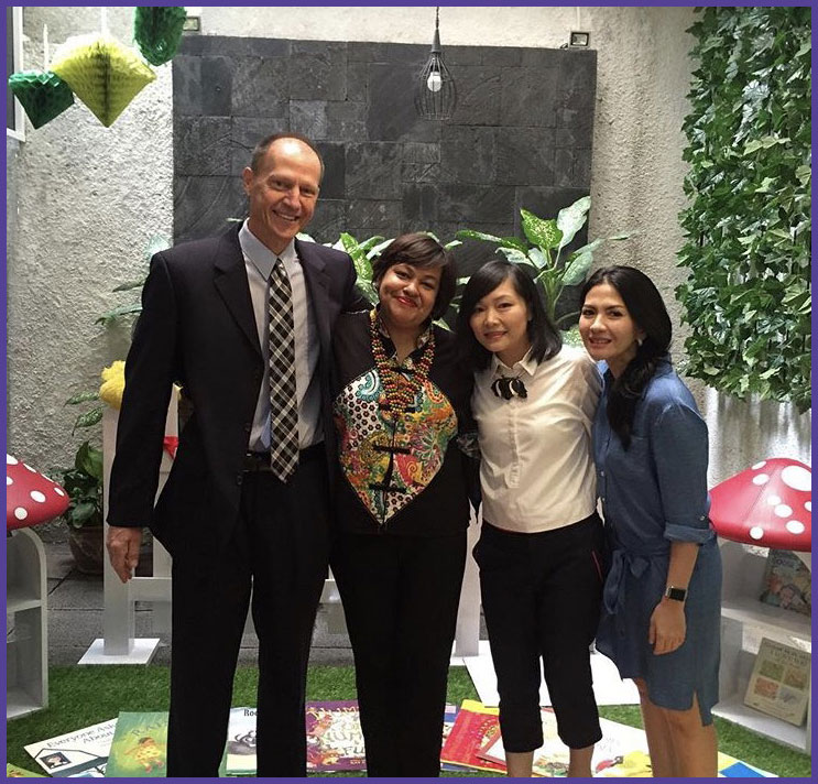Dr. Titzer with the administrators of early learning classes in Jakarta, Indonesia.